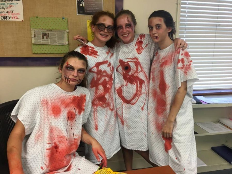 Sophomore representatives Charli Young, Sophie Ragano, Charlotte Carl, and Olivia Fernandez pose as patients after a surgery