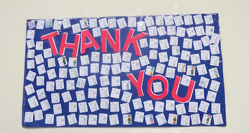 Academy students wrote thank you notes to military men and women and displayed them at the assembly. Credit: Emily Hoerbelt/Achona Online
