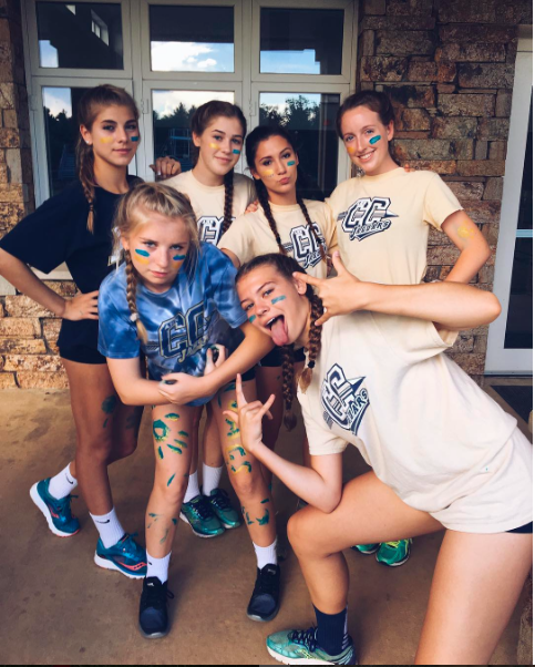 The girls have fun at conditioning by participating in paint wars.