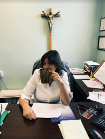 Principal Nitchals ready to take on a weekday at AHN, coffee in hand.