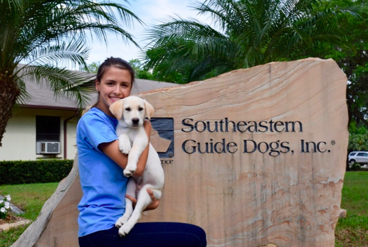 Folkman poses with Suba moments after picking him up from Palmetto, Florida, to begin his obedience training. Credit: Devin Folkman/ Achona Online