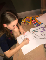 Sophomore Mary Kelly doing some art homework where she personalizes her name plate.
