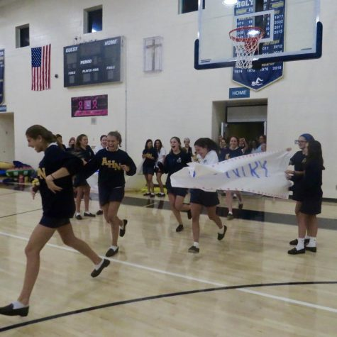 Freshman and sophomores  painted the team posters for the athletes to break through for an entrance. Photo Credit: Emily Anderson/Achona Online