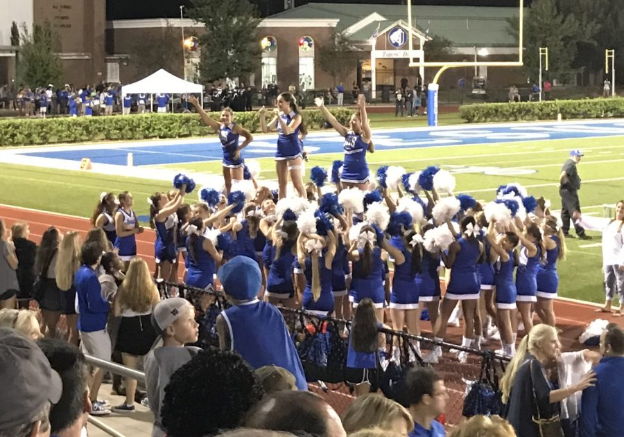 This year at the Homecoming game the Junior Varsity cheerleaders cheered along side the Varsity girls. That means  47 girls were cheering on the tigers, during the game.