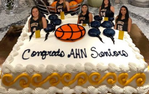 The senior's parents printed out figures of the players to put into their cake for pictures.