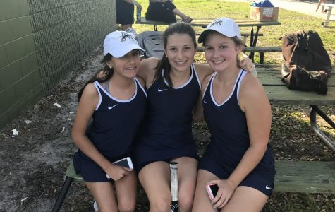 Isabella Duarte, Katherine Rodriguez, and Maddie Chandler rest before doubles matches. Photo Credit: Sara Phillips/ACHONAOnline