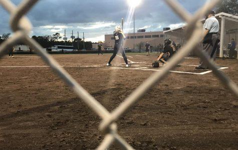 Maddie Boos ('20), number 15, plays alongside sister Chloe Boos ('19), number 42, on Academy's varsity softball team. Photo Credit: Sam Garateix/ achonaonline