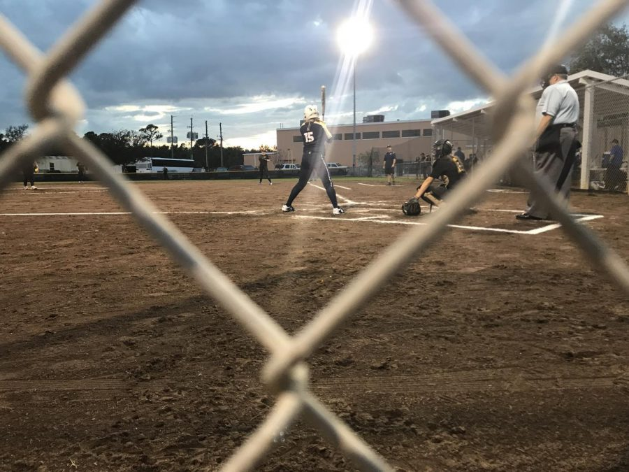 Maddie Boos (20), number 15, plays alongside sister Chloe Boos (19), number 42, on Academys varsity softball team. Photo Credit: Sam Garateix/ achonaonline