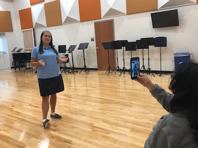 "Performing Arts teacher Vivian Kimbler says, ""The sheer fact that you are committed to doing this as a class -the sheer fact that every voice is heard- it gives every girl the chance to talk about what they do and how they contribute."""