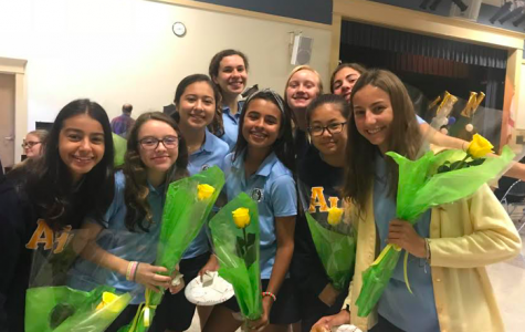 Each of the eight new TLC members received  a rose from each of the seniors in TLC.