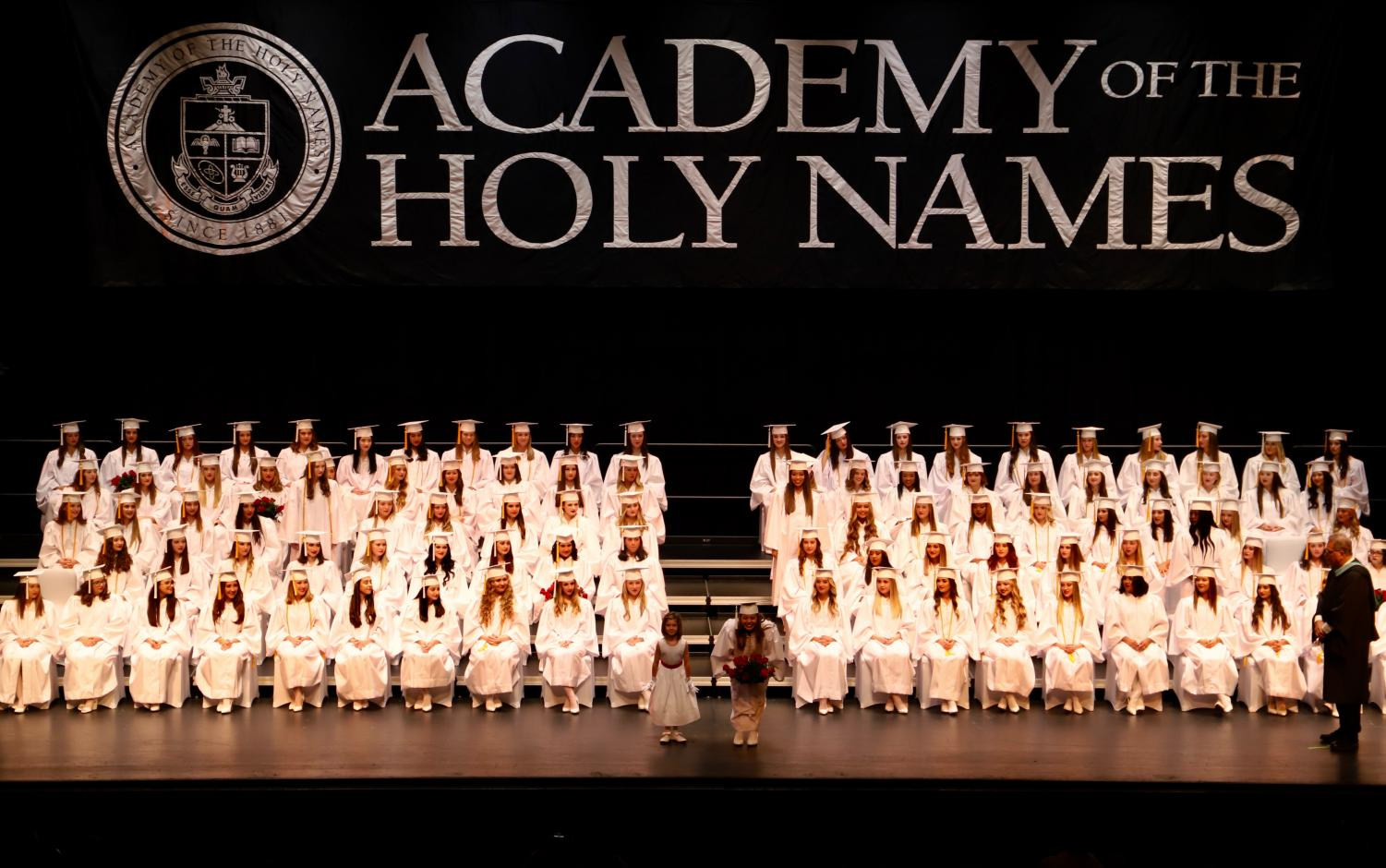 Academy+first+graders+handed+each+graduate+a+bouquets+of+red+roses.+