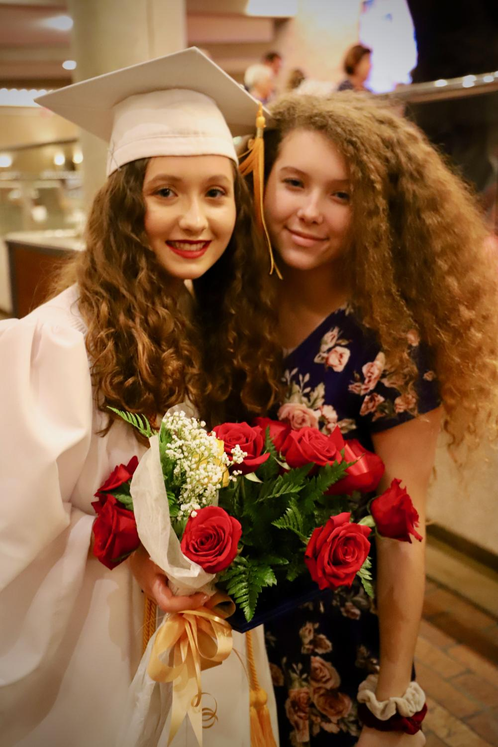 Bella+Ferrie+%28%2721%29+witnessed+her+now+graduated+sister+receiver+her+diploma+and+roses.+