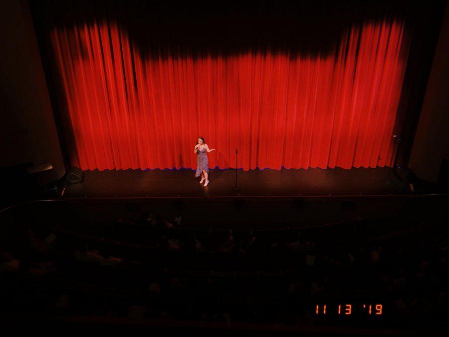 Senior Kennedy Wilson sings Shoulder to Shoulder.