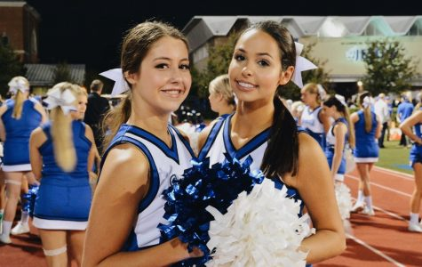 Lee (left) and Bissett (right) have both been members of the cheer team for four years.