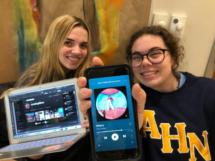 Natalie Gillis ('21) and Audrey Barnes ('21) show off their Spotify accounts.