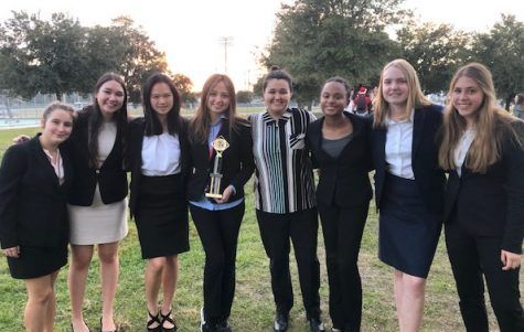 The competitors of the Academy of The Hoy Names Speech and Debate Team get in a picture after a lengthy meet. The competitors are eagerly awaiting the critiques from the judges and how they ranked.