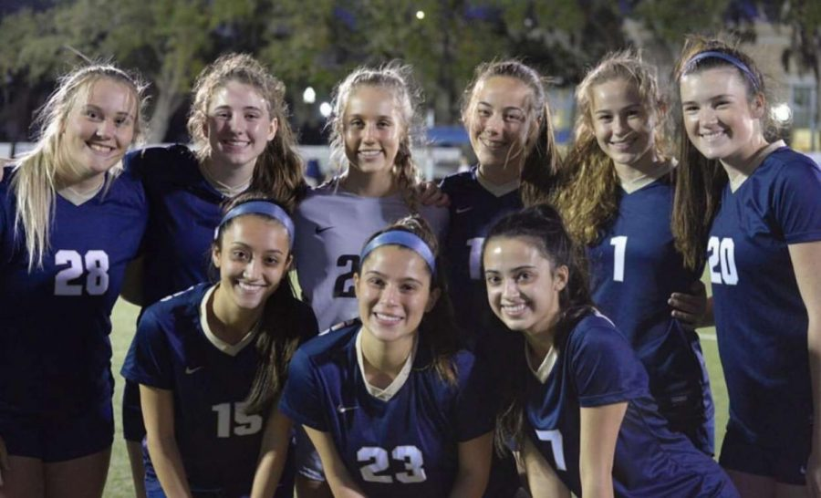 The senior members of the soccer team celebrate their senior night on January 17. The team earned a 1-0 victory over St. Petersburg High School.
