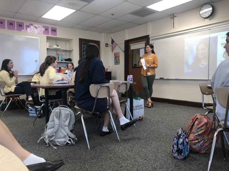 Alexis Rodriguez ('10) handed out Girl Scout cookies to girls who attended her presentation on public relations and journalism