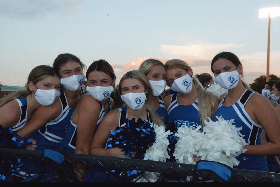 The Jesuit cheerleaders are thrilled to be back, even with masks.