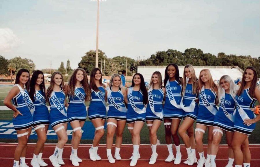This year's class of  2021 Varsity Jesuit Cheerleading Seniors.
