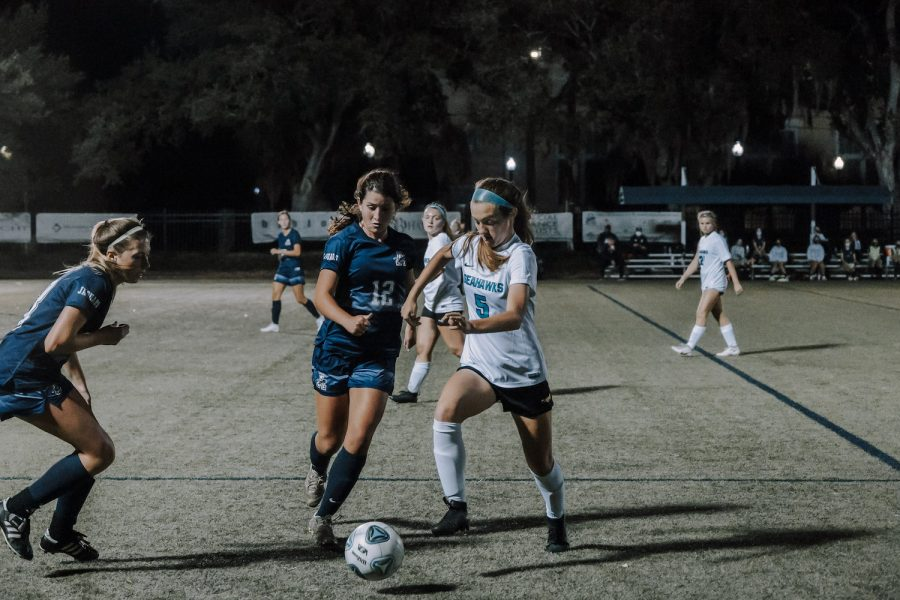 Jamie Potter ('22) and Maddie Hyer ('24) are featured in the above picture, facing off against Sunlake High School.