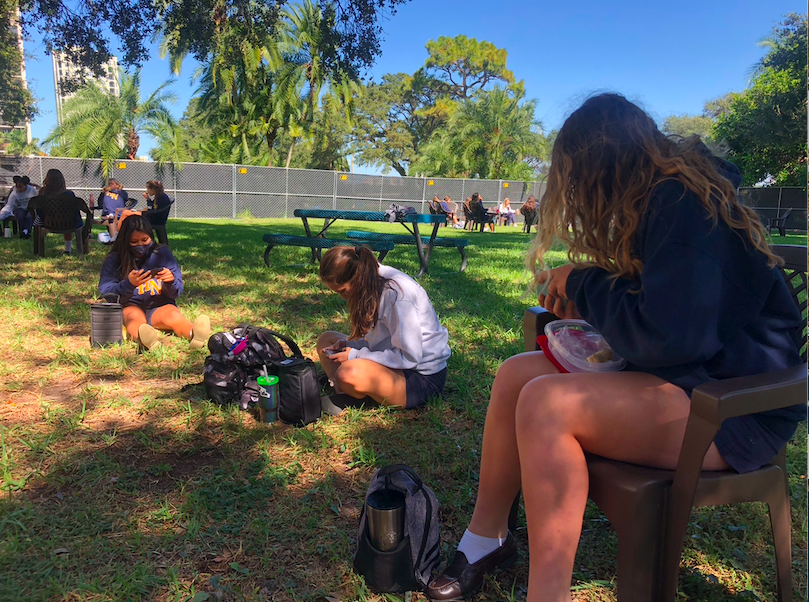 Academy students play Among Us during lunch in the Oak Grove