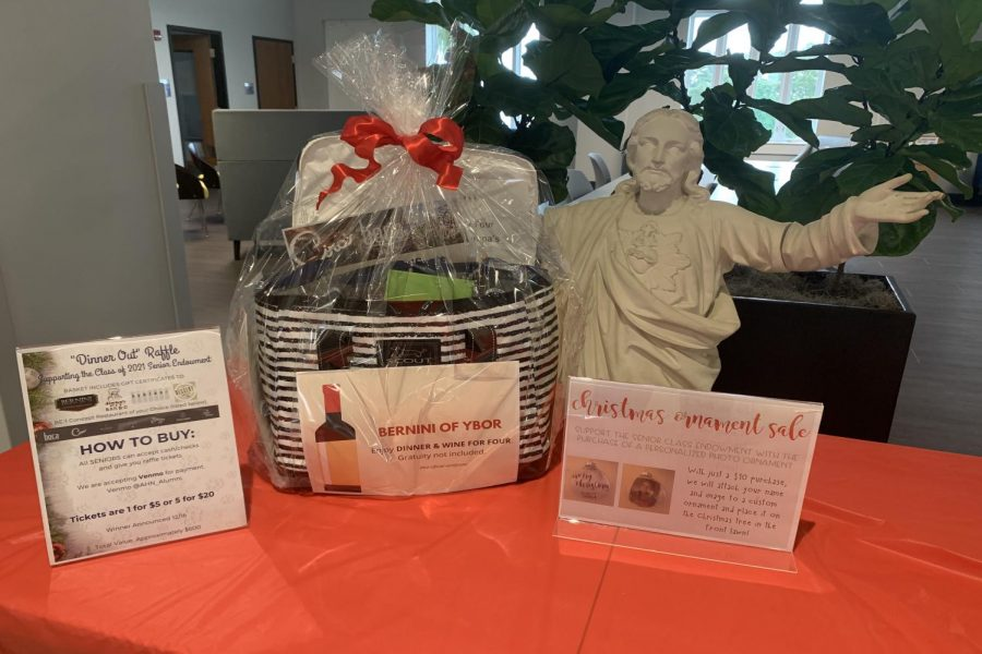 The basket that is being raffled for the Class of 2021 Senior Endowment is currently present in the second floor common area. Instructions for how to purchase raffle tickets and Christmas ornaments are also present with the basket.