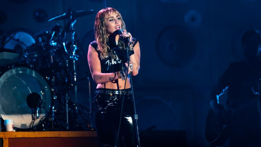 The above picture depicts Miley Cyrus performing in 2019.