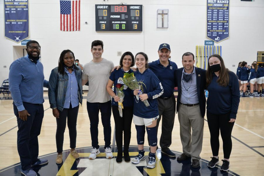Angie Pena ('21) poses with Coach Dennis, Coach Sherisha, Gabriel Pena (brother), Lidia Pena (mom), Victor Pena (dad), Coach Severini, and Coach Jessica Galvis.