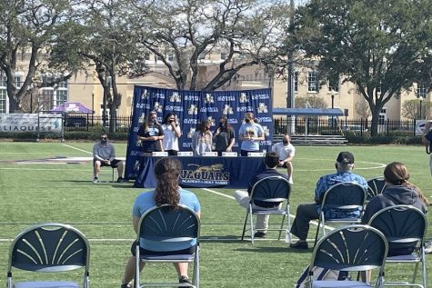Seniors Grace Cronen, Rachel Petrarca, Jessica, Reynolds, Maddie Rodriguez, and Belle Sardja commit to their respective colleges at AHN's Senior Signing.