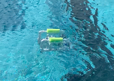 Baby Bot, a SeaPerch robot built by captains Maddie Glaum (21) and Olivia Scarpo (21), swims in the Academy pool after a successful motor test.