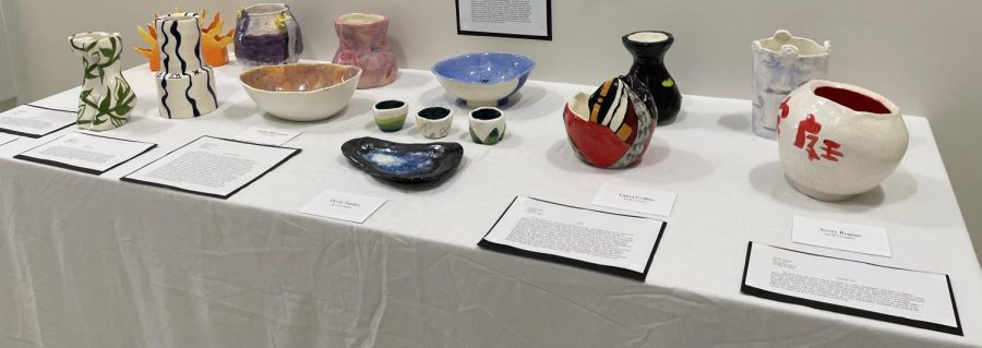 Art work was grouped together by class, including the tables dedicated to the Ceramics class shown here.