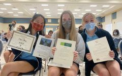 Juniors Grace Odmark, Claire Wong, and Lucy Dyer pose with their awards.