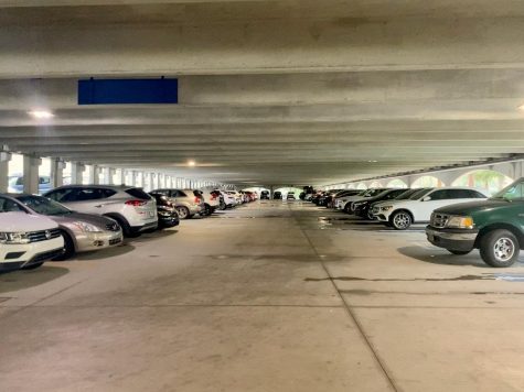 Juniors and Seniors park their cars in the parking garage near the arts building.
