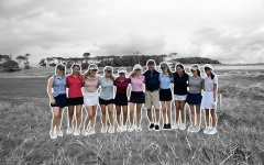 The 2021-2022 golf team members and Coach James.
