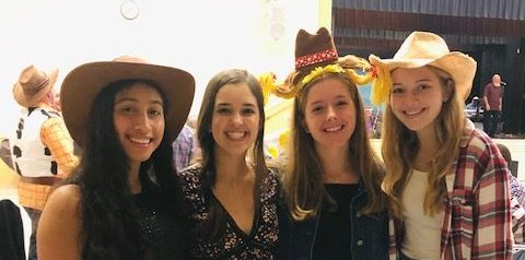 Leslie Sanchez, Ashley Canal, Lucy Dyer, and Maeve Miller (22), pose together at the western-themed Father Daughter Dance from a few years ago.